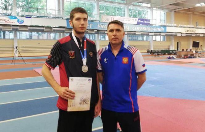 Алексей Каратаев с тренером Петром Маркиным